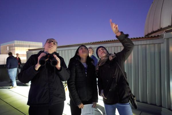 Students at a Star Party on the roof of Smith Lab